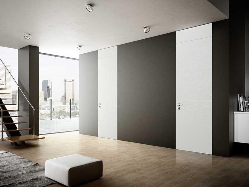 скрытая дверь до потолка в интерьере